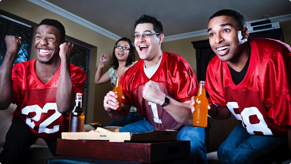 football fans watching the game on hdtv