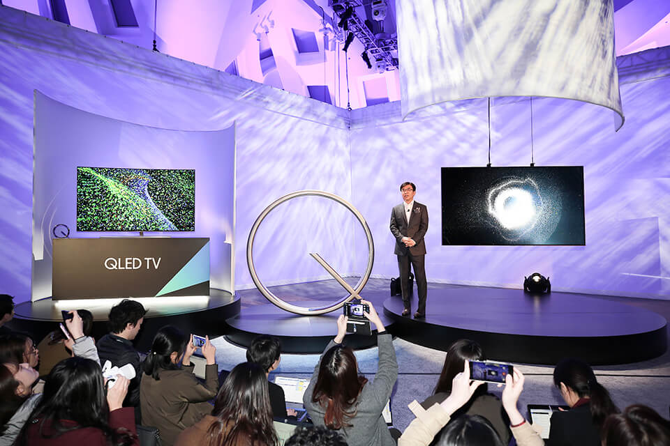 President Hyun Suk Kim, introduces the company's new QLED TVs